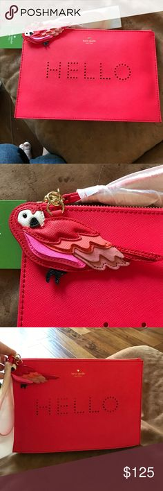 "KATE SPADE PERFORATED HELLO CLUTCH w/PARROT! This is a red Kate Spade perforated Clutch that the holes spell out ""HELLO"". It is a really big clutch and can hold a lot!! The parrot on the zipper is super cute in reds and pinks!! Look at the size below it is the biggest clutch/ wristlet I have seen! kate spade Bags Clutches & Wristlets"