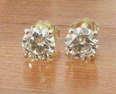 Stud Earrings 14K Yellow Gold Natural Diamonds 2 stones together weight 1.50 carat Each stone is 6 mm.  Setting  Metal type: 14K Yellow Gold  Setting type: 4-prongs Martini setting.  Main Stones Stone type: 100% Natural Diamonds Shape: Round Brilliant cut Weight: 1.50 carat / 6 mm. Color grade: M-N-O Clarity grade: SI2 Cut: Excellent Treatment: Clarity Enhanced  Includes: * Certificate of Authenticity * Exclusive Wooden Earring box * Elegant package * Free Shipping with EMS 3-5 days del...
