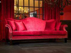 Large velvet studded sofa