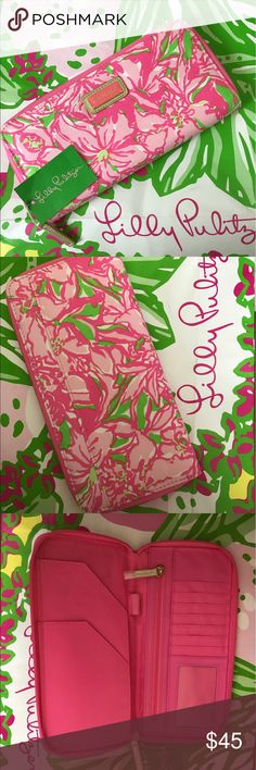 """Lilly Pulitzer Wallet Lilly Pulitzer Travel Wallet. Zipped closure. Spaces for ID and several card slots, check book and currency holder, plus a zippered pouch for change, and a pen holder. 5"""" x 9"""" Lilly Pulitzer Bags Wallets"""