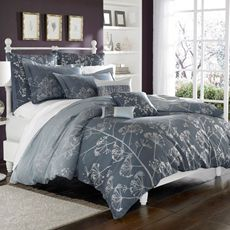 duvet cover in shades of blue and silver.  maybe with light grey walls and grey curtains.  108x96