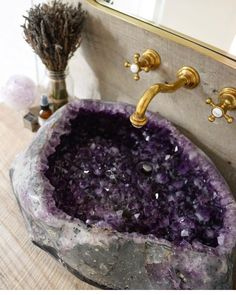 This Amethyst Geode sink is pretty amazing! I think I would only use it to cleanse crystals in.