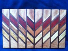 Beautiful, small cutting board and/or bread/cheese board. Made of sepele, walnut, padauk, cherry and limba wood, by ChopOffTheOldBlock at Etsy.com, $40.00 !!