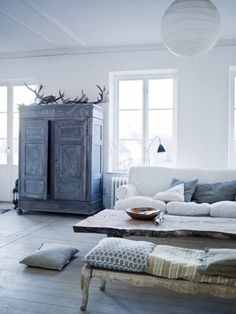 All white room and antlers.