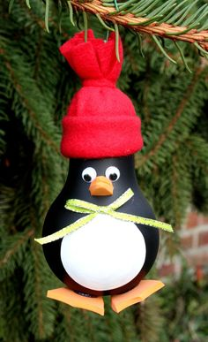 Penguin Christmas Tree Ornament  made from a recycled light bulb.