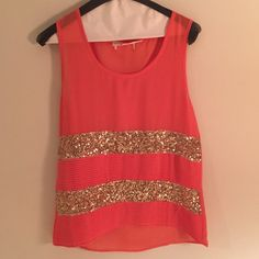 adorable orange & gold sparkly top! gorgeous orange cited top with two stripes of gold sequins! Purchased from a boutique so great quality and only worn once or twice! Perfect condition! Cut out the size tag because it itches but pretty sure it's a medium (if not then it's a small) Tops