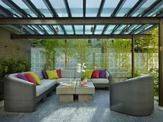 Love this outdoor covered patio ... especially the floor tiles and frosted glass roof (Toth Construction)