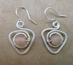 coiled earrings with center bead