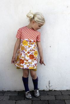I love the fabric combination. Also love that there are no silly cartoons on this dress. Hooray for moms that can sew!