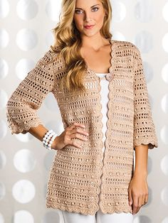 Double crochet clusters alternate with filet crochet rows to create the lacy striped pattern in this city-chic cardigan. An easy style and longer length make it comfortable and flattering for any woman. This e-pattern was originally published in the Spring 2014 issue of Crochet! magazine. Size: Includes Woman's S through 5XL. Made with light (DK) weight yarn and size F/5/3.75mm hook. Skill Level: Intermediate