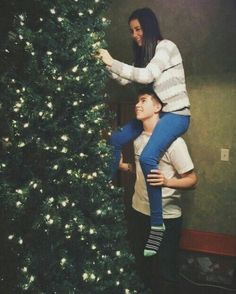Decorating the tree with your significant other makes for a great holiday photo.