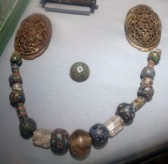 Tortoise brooches with string of glass beads, Viking Age, Norway