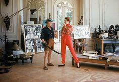Picasso in his Cannes studio with model, 1955.  Photo by Mark Shaw.