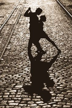Take your breath away with drama, artistry, and pure sensuality! This spectacular black-and-white beauty features a romantic couple engaged in an impromptu Tango, on the cobblestoned streets of France at night. From the composition, to the shadows, to the style, to the dancing magic, it's all here!