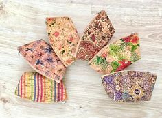 These natural colorful cork coin purse is very original and unusual! Perfect and unique eco-friendly present.    (choose your's style)    Features:    - Made from Cork-Eco-friendly material    - Soft and durable      External size: 12 x 10 cm.    How to c