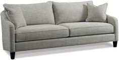 Suitable for any space, this versatile sofa is designed with cushy gray upholstery bolstered to a kiln-dried hardwood frame and tapered front legs. We especially love how its silhouette is angled in the back, mirroring the elegant curves of its modified English arms. Two matching throw pillows included. Furniture > Sofas > Sofas & Loveseats.