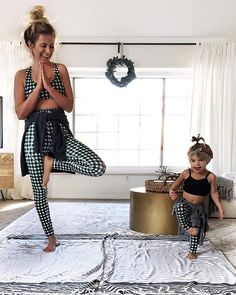 CLICK TO SHOP! When you've got kids this cute, you have to match with them! Say hello to @krista.horton and her darling mini me in our Agnes Gingham Leggings! This fitness outfit is perfect for hitting the gym, running errands, doing some yoga with your little one or lounging around the house! You'll be wearing these leggings all winter long and so will your mini me! To see more Albion Kids clothes, head to albionfit.com | @albionfit #kids #clothes #girls #minime #matching #mom #fitness