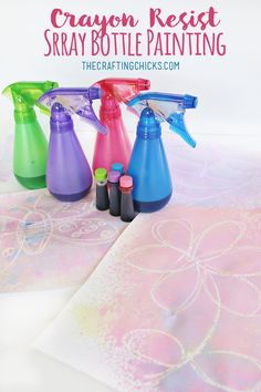 Crayon Resist Spray Bottle Painting for Summer fun Art!  Paint outside with spray bottles and food coloring.  A fun crayon resist art project for summer!