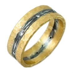 24k and oxidized textured silver (in the center) hammered finish ring by Kurtulan with burnish set diamonds across the ring. Priced upon request.