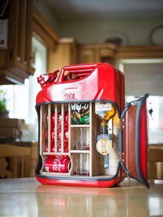 The original jerry can minibar. It comes fully equipped with a mounted optic, wooden coke rack, two tumbler glasses, snack shelf and lockable door to keep your emergency fuel safely contained.Product InformationWeight: 8kgSize: 470mm x 165mm x 345mmHolds 1 x 200ml - 360ml bottle (depending on type) and 5 x 330ml cansFood and drink not supplied