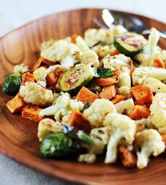 Roasted winter vegetables with miso lime dressing.