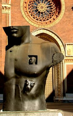 Igor Mitoraj - Piazza del Carmine, Milan, Italy, Province of Milan, Lombardy. Polish-born sculptor Igor Mitoraj greatly admires classical civilization and has built a repertoire based on imagery that evokes the ancient Greco-Roman world.