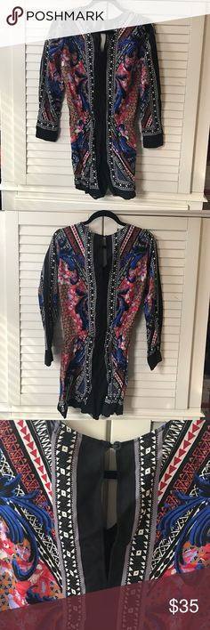 NWT Printed Romper ••NWT•• printed long sleeve Romper. Cinched at waist. Keyhole detail on back. •Make me an offer! Anything is negotiable!• listed as Zara for exposure Zara Pants Jumpsuits & Rompers
