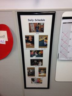 Daily Picture Schedule framed on wall. Easy to make my own with pictures from around the house