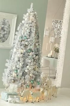 A White Christmas Tree- A chic white Christmas tree adds a very winter feel in your home for the holidays. Christmas pin board by Asher Socrates. #christmas #holiday #gift #love #fun