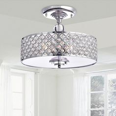 The Martina Chrome Finish Crystal 3-light Flush Mount Chandelier features a chrome finish, with a base and shade made of iron. 3-light set-up allows for a clean, complete look with lots of illuminatio