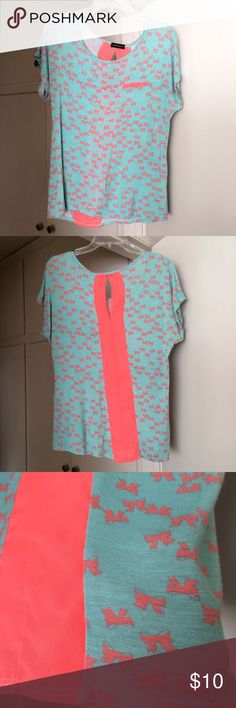 FLASHMOB Tee with bows Love the neon colors on this top! Fun tee with cute little bows all over. Great condition, gently worn. Size is XL fits like a L. Pocket on front is just for design, not a real pocket. 95% rayon, 5% spandex. Colors are teal and neon pink FLASHMOB Tops