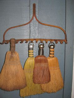 I love this concept of using an old rake head to hang things. Instead of whisk brooms you could hang key rings, necklaces, upside-down wine glasses, etc.