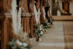 Gorgeous chapel floral decor for each church pew bench | Image by Radu Benjamin