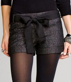"Cute shorts. Black Ribbon bow ""belt"". Tights and heels or booties."