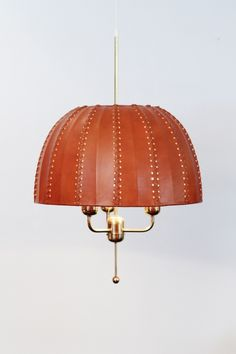 Hans Agne Jakobsson; Brass and Leather Ceiling Light for H.A.J. Markaryd, 1950s.