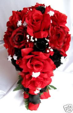 Red white & black bouquet- these are pretty not sure if they are for wedding/fake or real but pretty