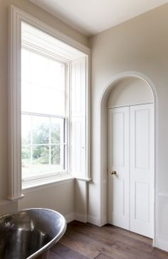 Reinstatement by Atkey and Company of the window reveals, shutters, architrave and doors from phase one of the refurbishment works to Pell Wall Hall by Sir John Soane, 1828. http://www.atkeyandco.com/products/doors/