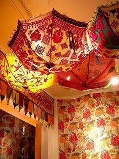 i kinda love the hanging umbrella idea...i may be on a quest for random fun umbrellas now!