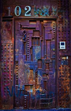 Soho, NYC, New York, USA. ~ It's an artsy place, but Door 102 on Greene Street, is one of a kind. The late artist William Tarr designed this metal creation for his own home.