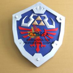 Item Detail Zelda Link Hylian Shield Cosplay Prop Includes - Prop Set Important Information: Primary Material - EVA, PVC, Light Wood, PU Leather Safety - All props are made with convention/event safe