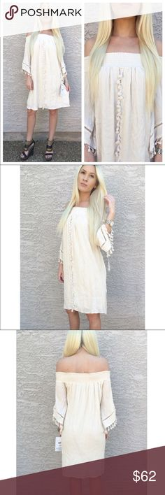Cream bohemian off the shoulder Dress Gorgeous cream linen off the shoulder dress. Pom Pom detail thought dress. Elastic stretch off the shoulder design. Pair with your favorite wedges and a purse with a pop of color. Lined. Dresses Strapless