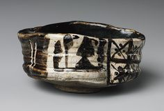 Clog–shaped chawan with design of plum blossoms and geometric patterns, Momoyama period (1573–1615)