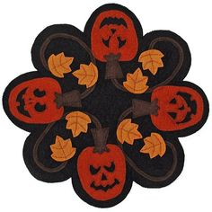 Have fun making this free table mat for Halloween…or omit the Jack's faces and have a pumpkin mat for the entire Fall!