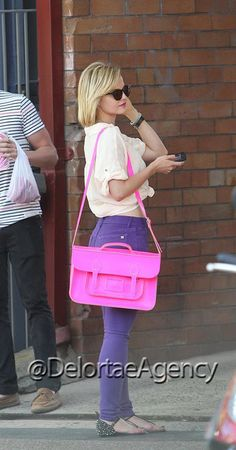 "American actress, fashion designer, and model Mena Alexandra Suvari spotted out and a bout with our favourite The Cambridge Satchel Company 15"" Fluorescent Pink Batchel bag.  Always lovely to see her and a pleasure to see her fabulous Batchel.  *courtesy of Delortae Agency UK's exclusive luxury authentic handbag SPA Visit us on Facebook: www.facebook.com/DelortaeAgency"