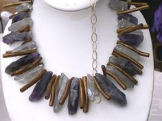 primitive ethnic tribal gemstone designer necklace  Euro 220  An exclusive Beadart Design! Natural amethyst and smokey quartz chunks are highlighted with gold coral branches.   A very unusual and outstanding design.
