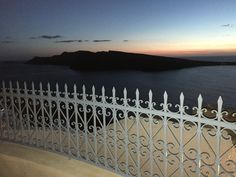 View of the sunset from Oia Mansions front Yard.  Oia, Santorini Island, Greece www.oiamansion.com