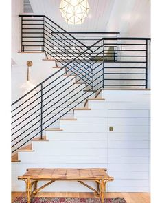 Get this look with our UFP-Edge Farmhouse White smooth shiplap. I love the wall paneling on this staircase. The modern farmhouse feel of this staircase is so beautiful. Architecture Restaurant, Architecture Design, Garde Corps Aluminium, Iron Stair Railing, Banisters, Kitchens And Bedrooms, Beach House Decor, Home Decor, Beach Houses