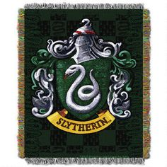 Don't miss out on this EXCLUSIVE Slytherin tapestry throw! Featuring the Slytherin crest and embroidered with gold thread throughout, this throw blanket will transform any living room into a magical dwelling.