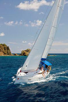 The Sunsail 41 Monohull Sailing Through Bright Blue Waters Of BVI
