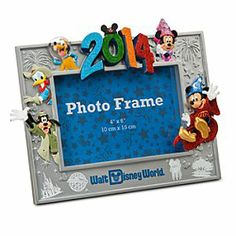 Sorcerer Mickey Mouse and Friends Photo Frame - Walt Disney World 2014 | Disney StoreSorcerer Mickey Mouse and Friends Photo Frame - Walt Disney World 2014 - Display magical memories of your Walt Disney World visit in our souvenir sculptured frame featuring Sorcerer Mickey and the gang plus 2014 logo in glittering dimensional relief.